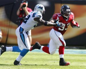 Michael Turner stiff arm Falcons